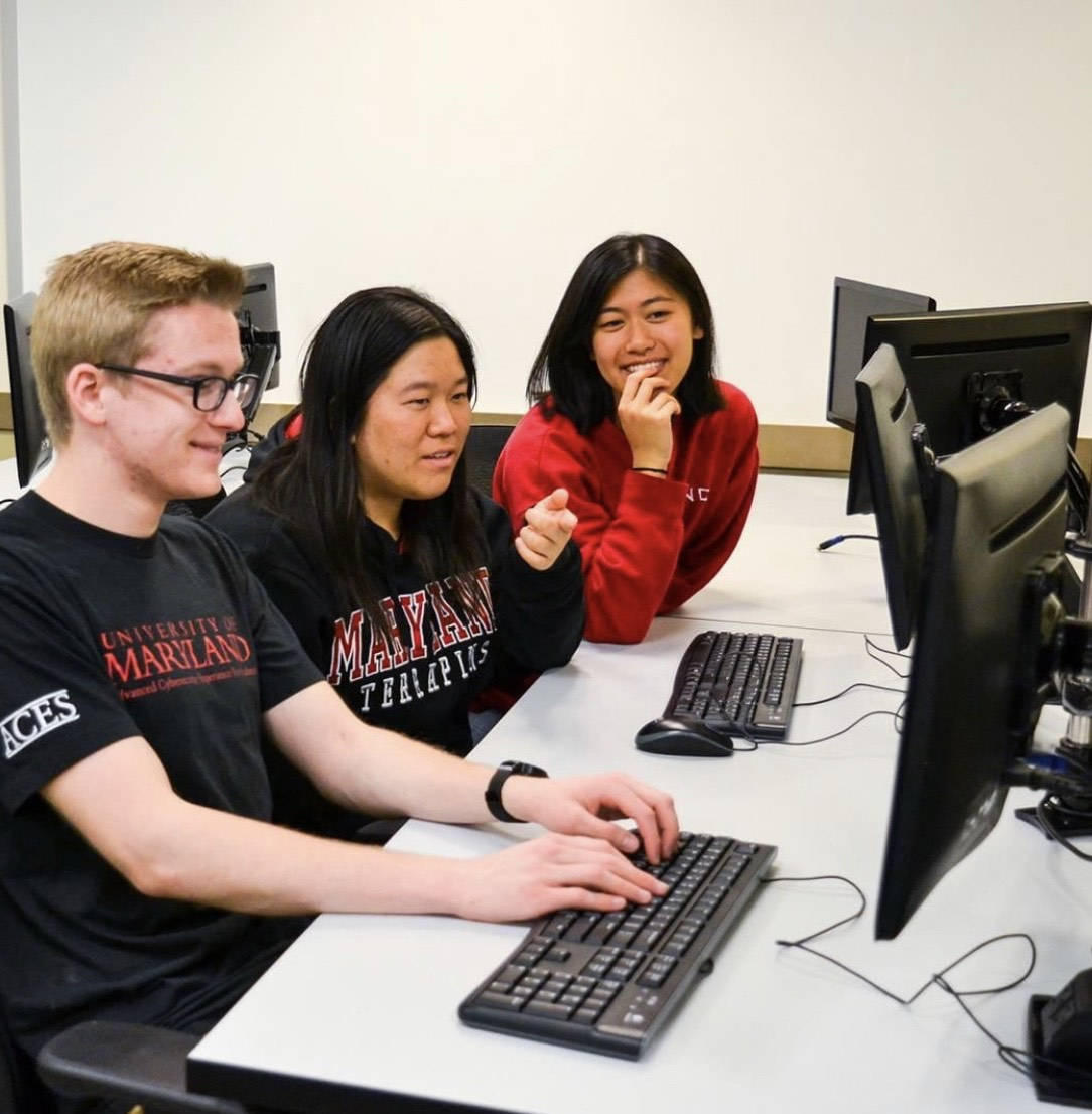 Three ACES students working at a computer