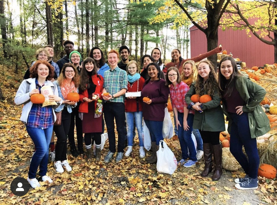 Honors Humanities students posing for picture with pumpkins